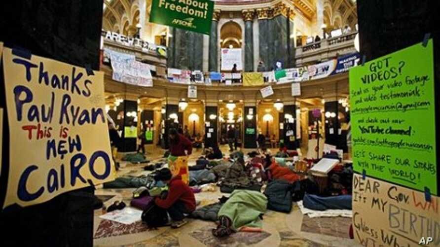 Opponents to the governor's bill to eliminate collective bargaining rights for many state workers sleep on the floor of the rotunda at the state Capitol in Madison, Wisconsin, at the start of the tenth day of protests, February 24, 2011