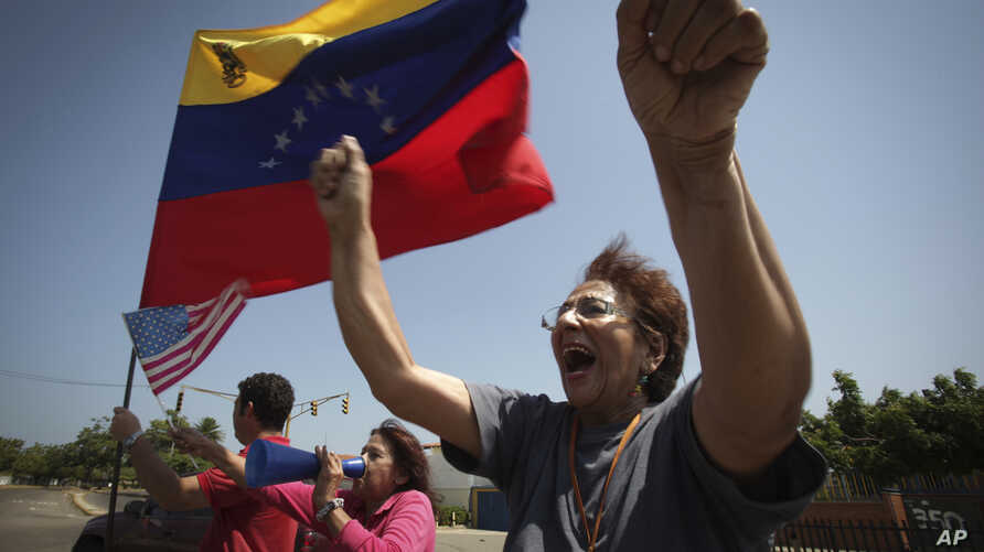 A woman chants anti-government slogans in a walkout against President Nicolas Maduro, in Maracaibo, Venezuela, Jan. 30, 2019.