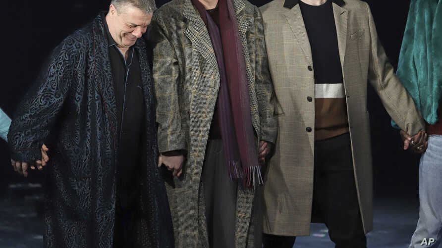"""(L-R) Nathan Lane, Andrew Garfield and James McArdle participate in the curtain call for the """"Angels in America"""" Broadway revival opening night at the Neil Simon Theatre, March 25, 2018, in New York."""