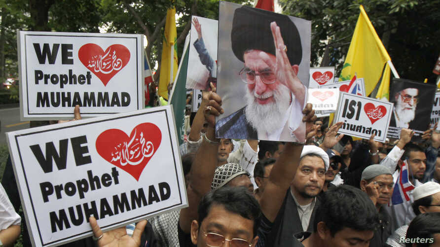 Muslim demonstrators hold banners during a protest in front of the U.S. embassy in Bangkok September 18, 2012.