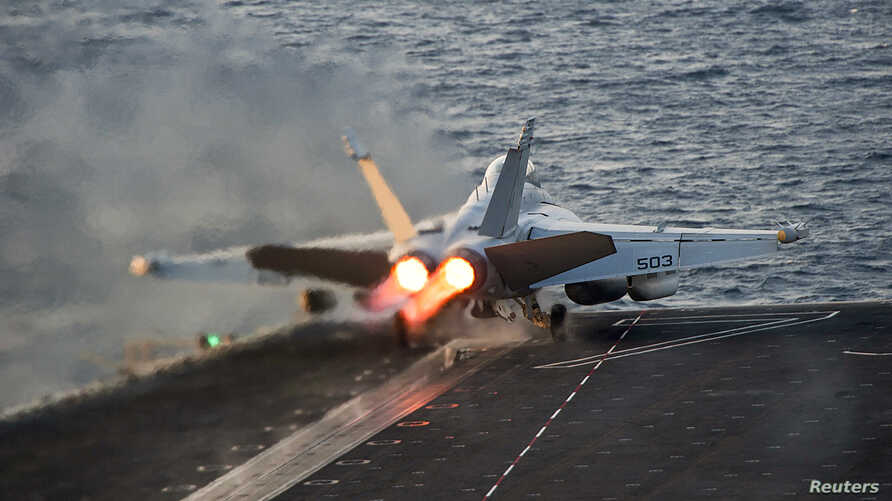 FILE - An EA-18G Growler launches from the Nimitz-class aircraft carrier USS Carl Vinson (CVN 70) in this U.S. Navy picture taken in the Arabian Gulf, October 28, 2014.