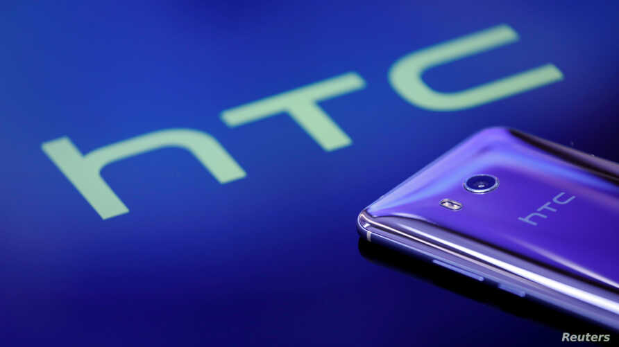 FILE - Google is buying a piece of HTC, which made Google's Pixel phone.