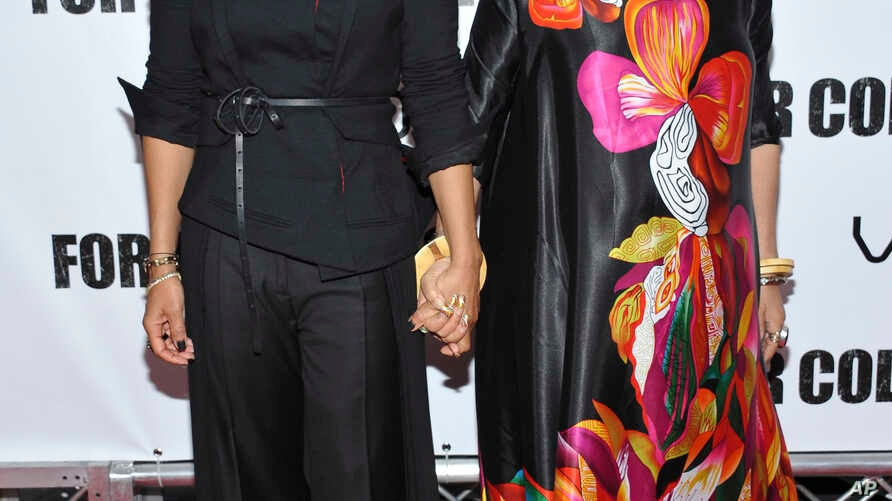 """FILE - Actress Janet Jackson, left, and author Ntozake Shange attend a special screening of """"For Colored Girls"""" at the Ziegfeld Theatre in New York. Playwright, poet and author Ntozake Shange, whose most acclaimed theater piece is the 1975 Tony Award"""