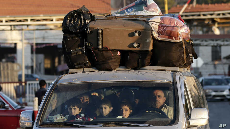 A Syrian family crosses into Lebanon at the border crossing in Masnaa, eastern Lebanon, November 30, 2012.