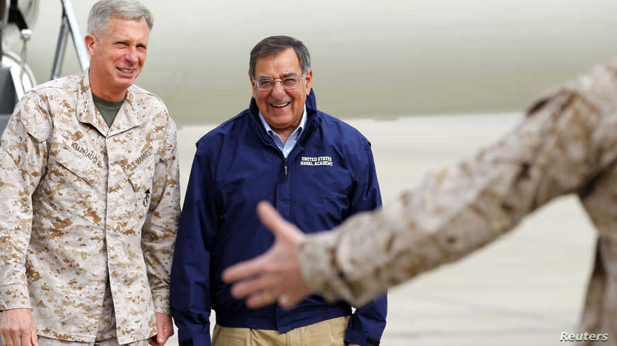 FILE - Lt. General Thomas Waldhauser, left, of 1st Marine Expeditionary Force greets then-U.S. Secretary of Defense Leon Panetta upon his arrival at Camp Pendleton, Calif., March 30, 2012. Waldhauser is President Barack Obama's nominee to lead the U.