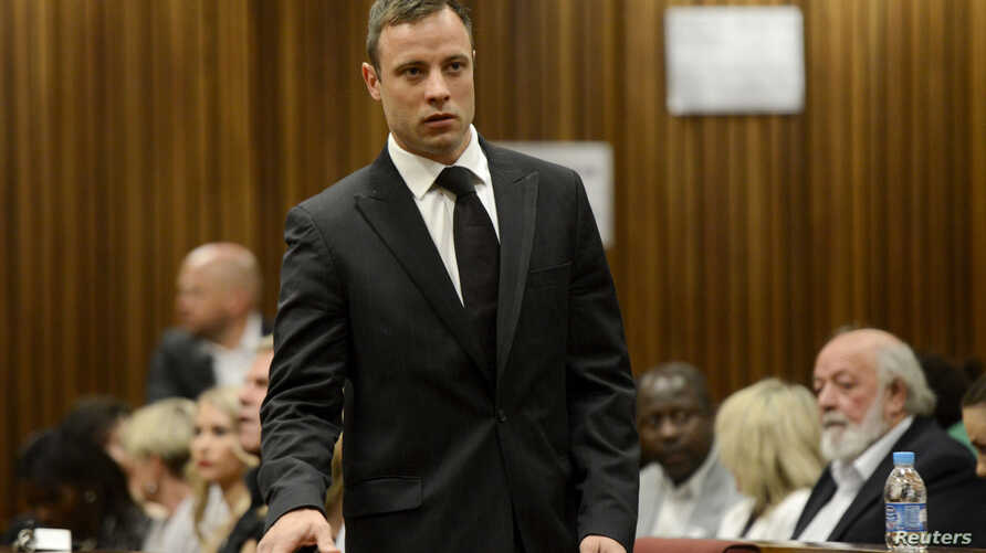 South African Olympic and Paralympic track star Oscar Pistorius attends his sentencing at the North Gauteng High Court in Pretoria, October 21, 2014.