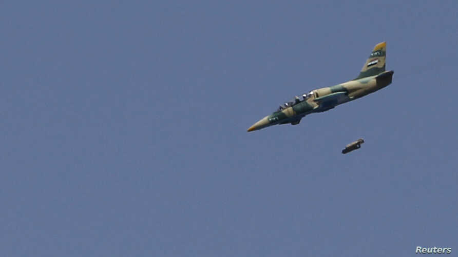 A Syrian Air Force fighter jet launches missiles at El Edaa district in Syria's northwestern city of Aleppo, September 1, 2012.