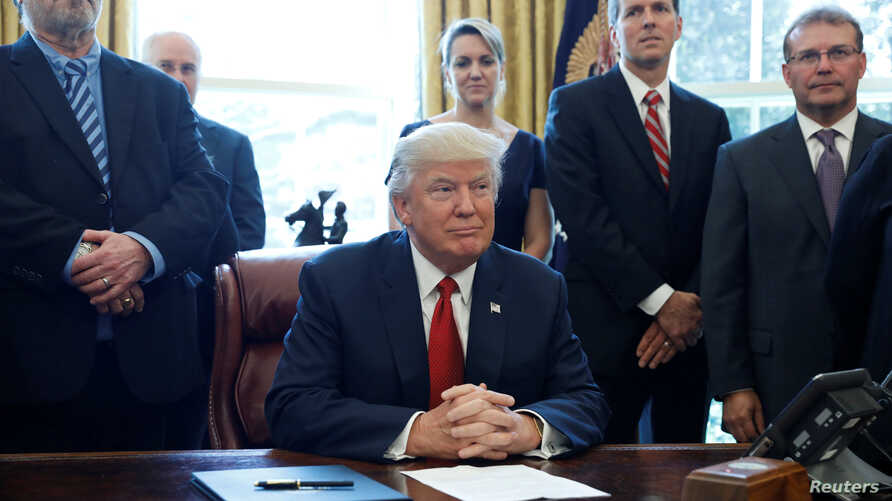 U.S. President Donald Trump speaks before signing a directive ordering an investigation into the impact of foreign steel on the American economy in the Oval Office of the White House in Washington, April 20, 2017.