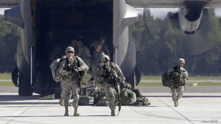 FILE - Soldiers from the U.S. 173 airborne brigade, who are among the troops participating in the exercises in western Ukraine, are seen exiting a C-130 transport plane.