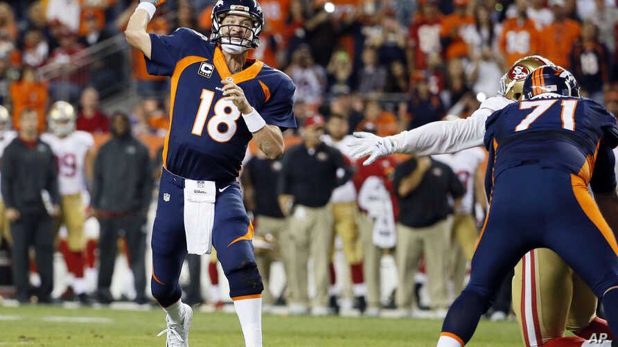 Denver Broncos quarterback Peyton Manning throws his 509th career touchdown pass during the first half of an NFL football game against the San Francisco 49ers in Denver, Oct. 19, 2014.