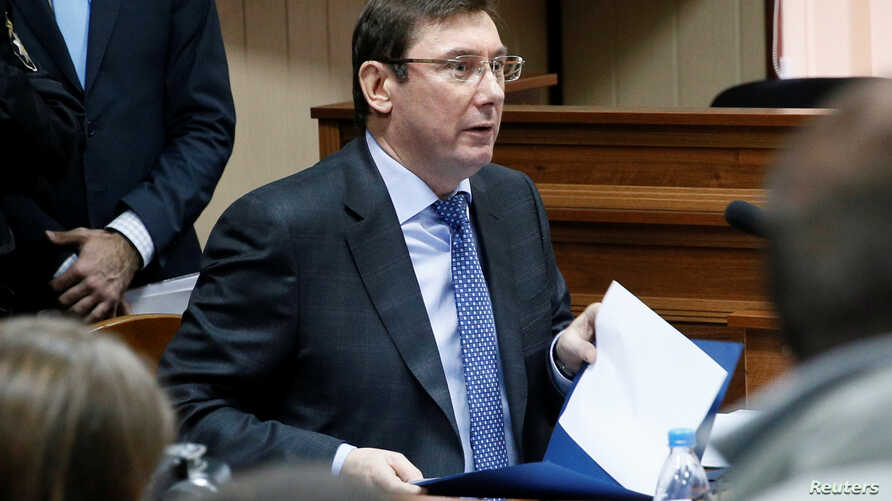 FILE - Ukraine's Prosecutor General Yuriy Lutsenko attends the trial of former riot police officers, suspected of killing protesters during the Maidan street revolt of 2013/2014, at a court in Kyiv, Nov. 28, 2016. Lutsenko said recently that investig