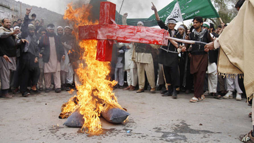 Afghans in Jalalabad  burn an effigy depicting U.S. President Barack Obama following Sunday's killing of civilians in Panjwai by a U.S. soldier.