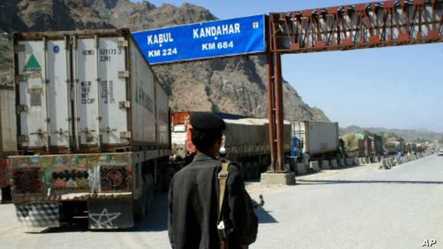 A Pakistani border guard stands near Afghanistan-bound NATO trucks parked on the roadside in Pakistani tribal area of Khyber. (File Photo)