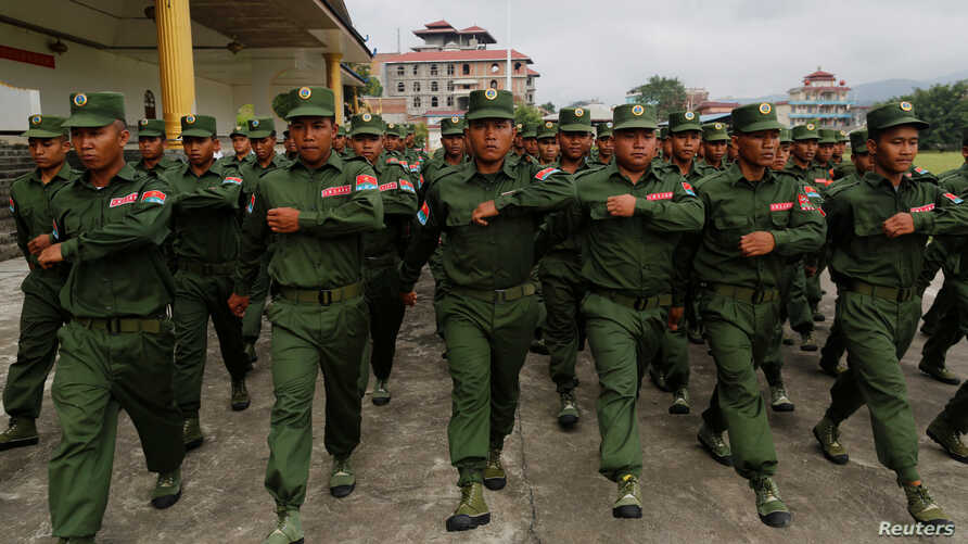 United Wa State Army (UWSA) soldiers march during a media display in Pansang, Wa territory in northeast Myanmar, Oct. 4, 2016.