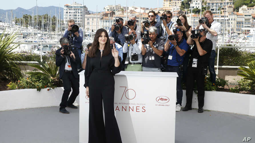 Ceremony host Monica Bellucci poses for photographers during the photo call for the film Ismael's Ghosts, at the 70th international film festival, Cannes, southern France, May 16, 2017.