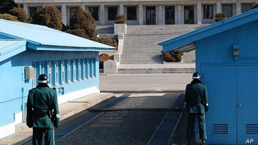 The ROK soldier on the right positions himself so as to be a difficult target for the North Koreans should shooting erupt at the JSA (File Photo - February 2011).
