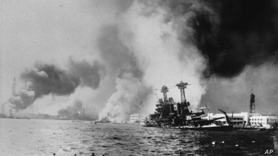 The USS California, right, after being struck by a torpedo and a  bomb during the Japanese attack on Pearl Harbor on Dec. 7, 1941.