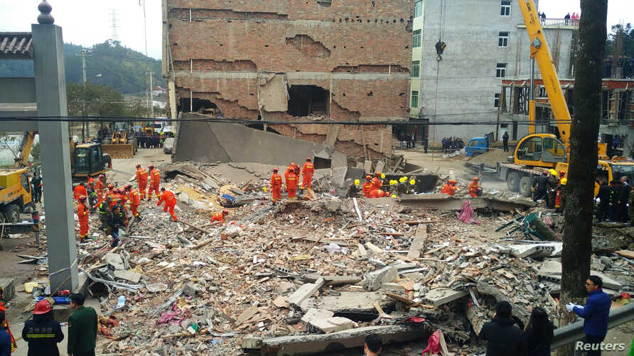 Rescue workers search the site where three five-story residential buildings collapsed in Wenzhou, Zhejiang province, China, Feb. 2, 2017