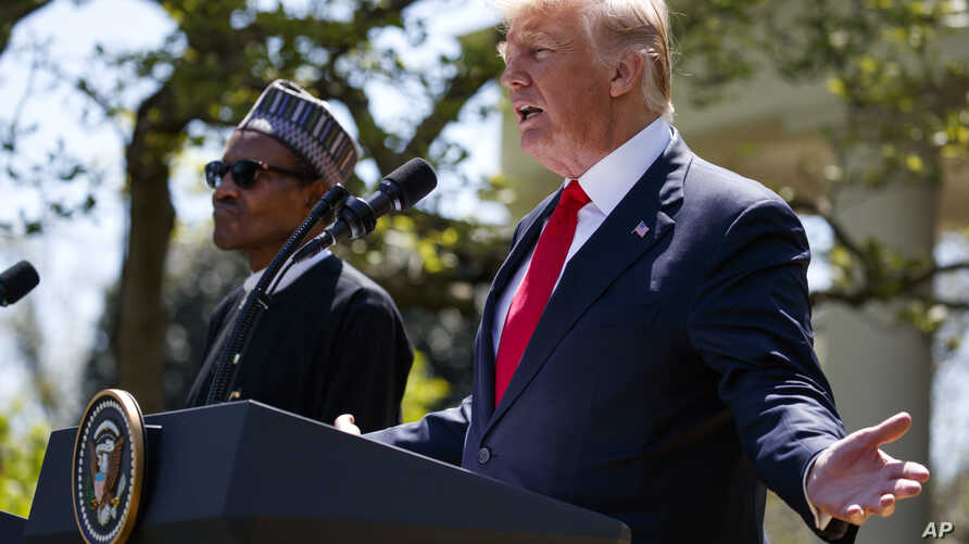 President Donald Trump gestures  during a news conference with President Muhammadu Buhari in the Rose Garden of the White House,  April 30, 2018, in Washington.