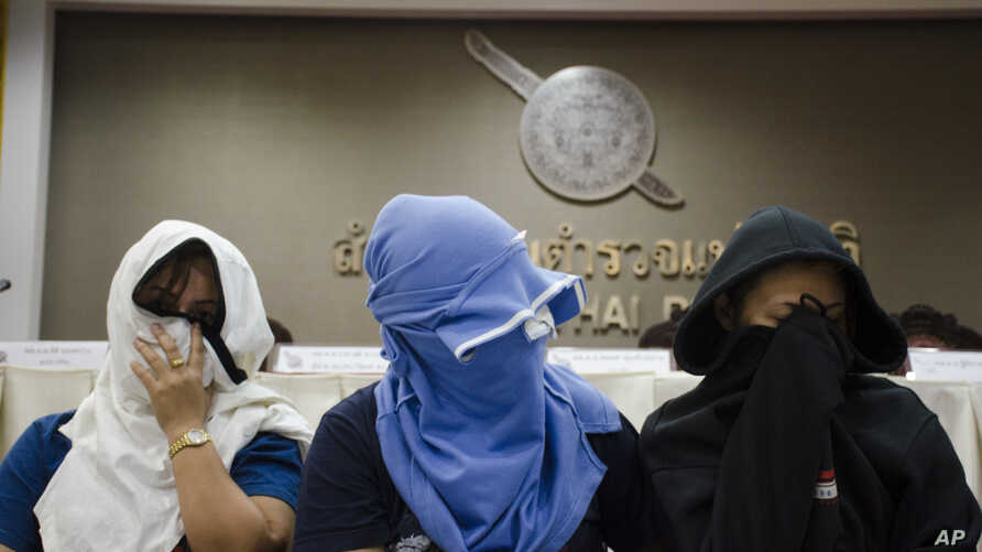 Unidentified Thai suspects of human trafficking appear at a news conference at police headquarters in Bangkok, Thailand, Aug. 4, 2015.