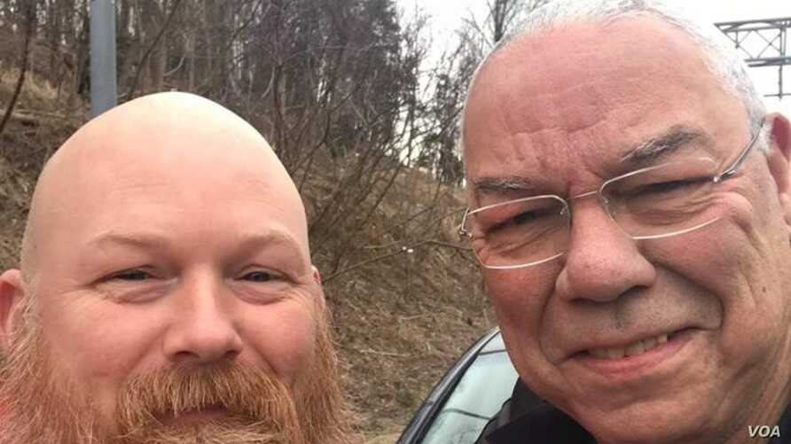 Afghanistan war veteran Anthony Maggert, with General Colin Powell in a photo posted on Powell's facebook page.