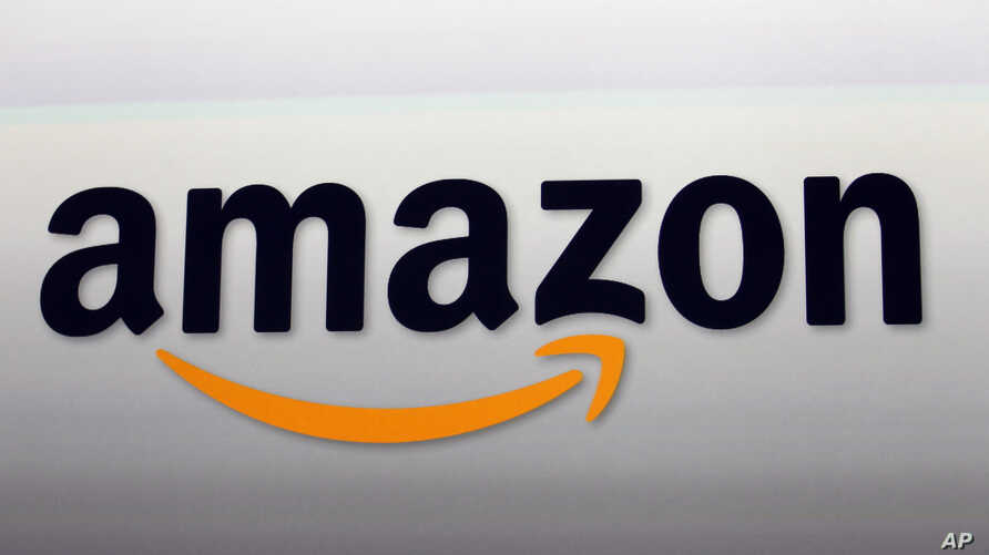 FILE - Amazon's logo. Amazon is attempting to develop glasses that pair with Alexa and would allow users to access the voice-activated assistant outside the home, according to a newspaper report, Sept. 20, 2017