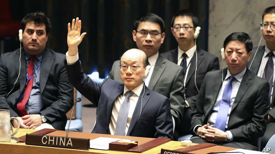 Chinese Ambassador to the United Nations Liu Jieyi votes during a Security Council meeting at U.N. headquarters on a new sanctions resolution that would increase economic pressure on North Korea to return to negotiations on its missile program, Aug.