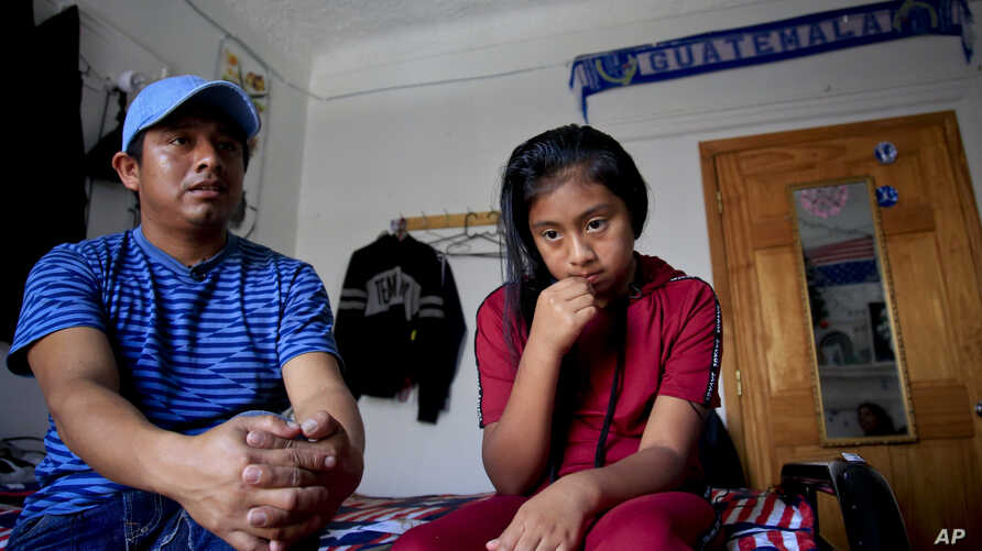 Manuel Marcelino Tzah, left, and his daughter Manuela Adriana, 11, sit inside their apartment during an interview hours after her release from immigrant detention, Wednesday July 18, 2018, in Brooklyn borough of New York. The Guatemalan asylum seeker