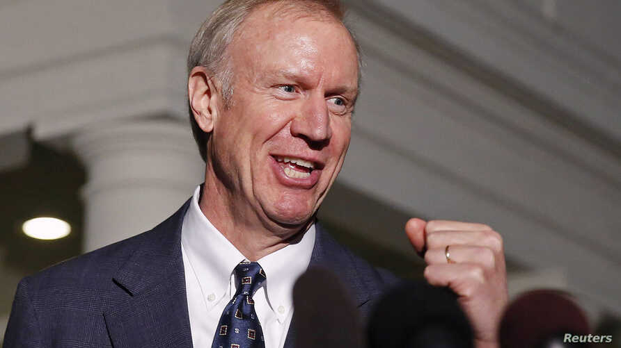 FILE - Illinois Gov-elect Bruce Rauner talks to the media after a meeting with U.S. President Barack Obama at the White House in Washington, Dec. 5, 2014.