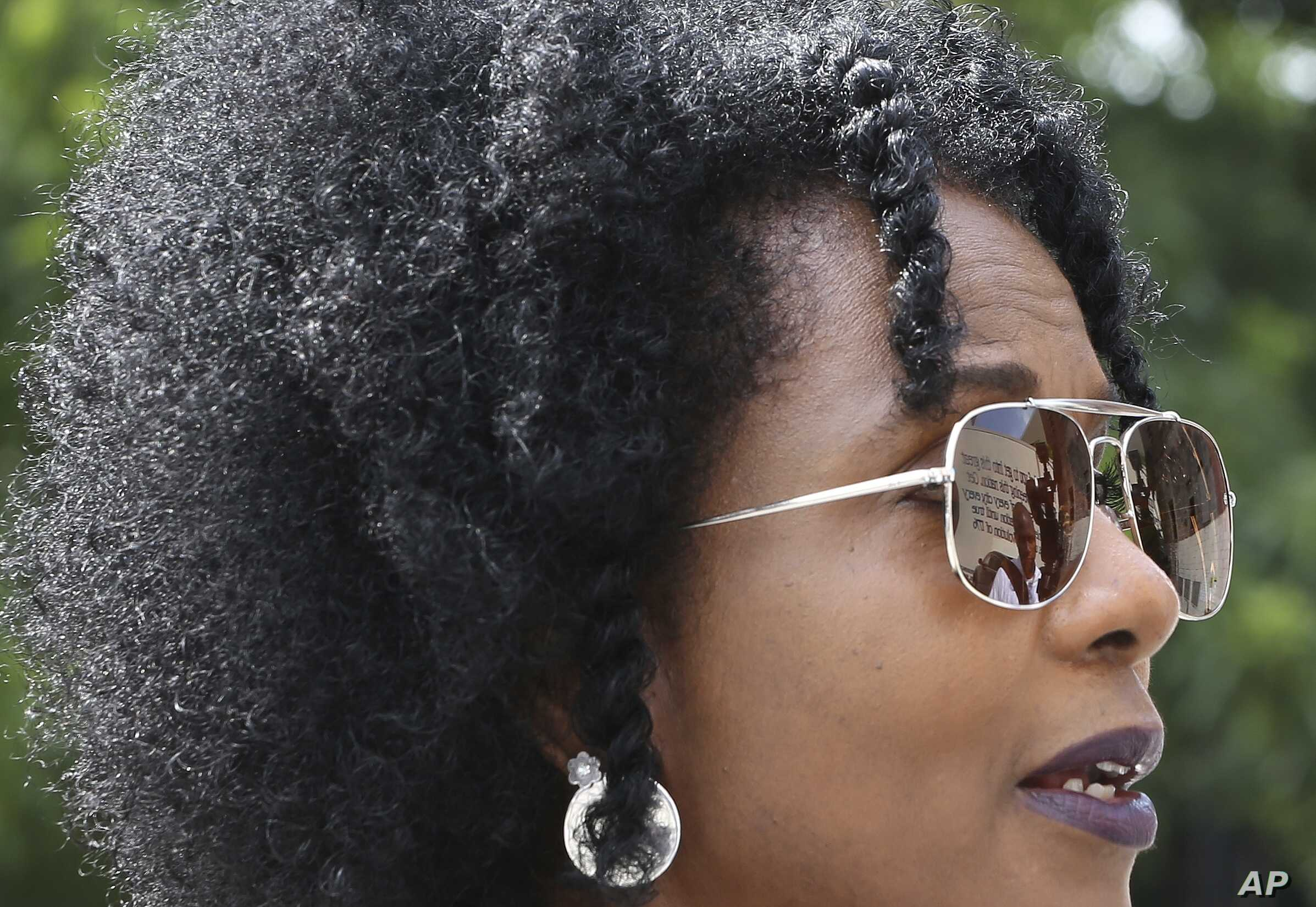 """In this June 28, 2018 photo, artist Sheila Pree Bright, 51, speaks during a press conference announcing """"Off the Walls."""" The program will create up to 30 murals to be installed around Atlanta  before the 2019 Super Bowl."""