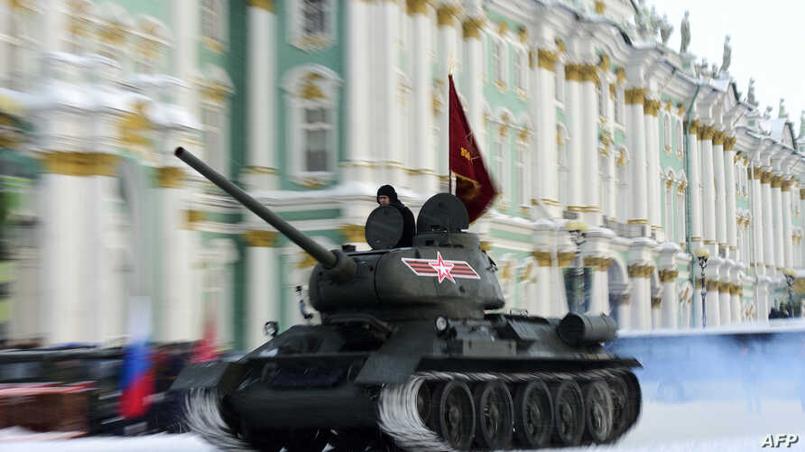 FILE - A Soviet WWII-era T-34 tank rolls on Dvortsovaya Square during the general rehearsal of Jan. 27 military parade marking the 75th anniversary of the lifting of the Nazi siege of Leningrad, in Saint Petersburg, Jan 24, 2019.