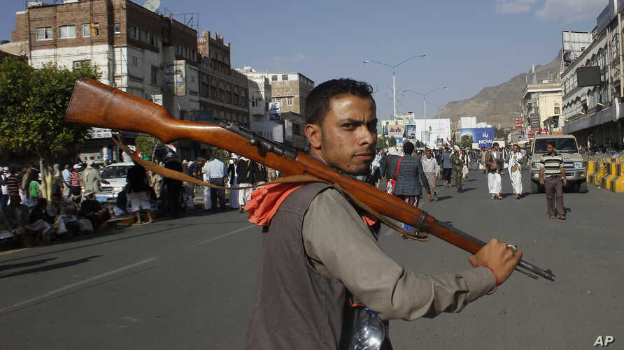 A Houthi Shiite rebel joins protests against Saudi-led airstrikes at a rally in Sana'a, Yemen, April 1, 2015. The air raids hit Shi'ite rebel positions in both north and south Yemen.