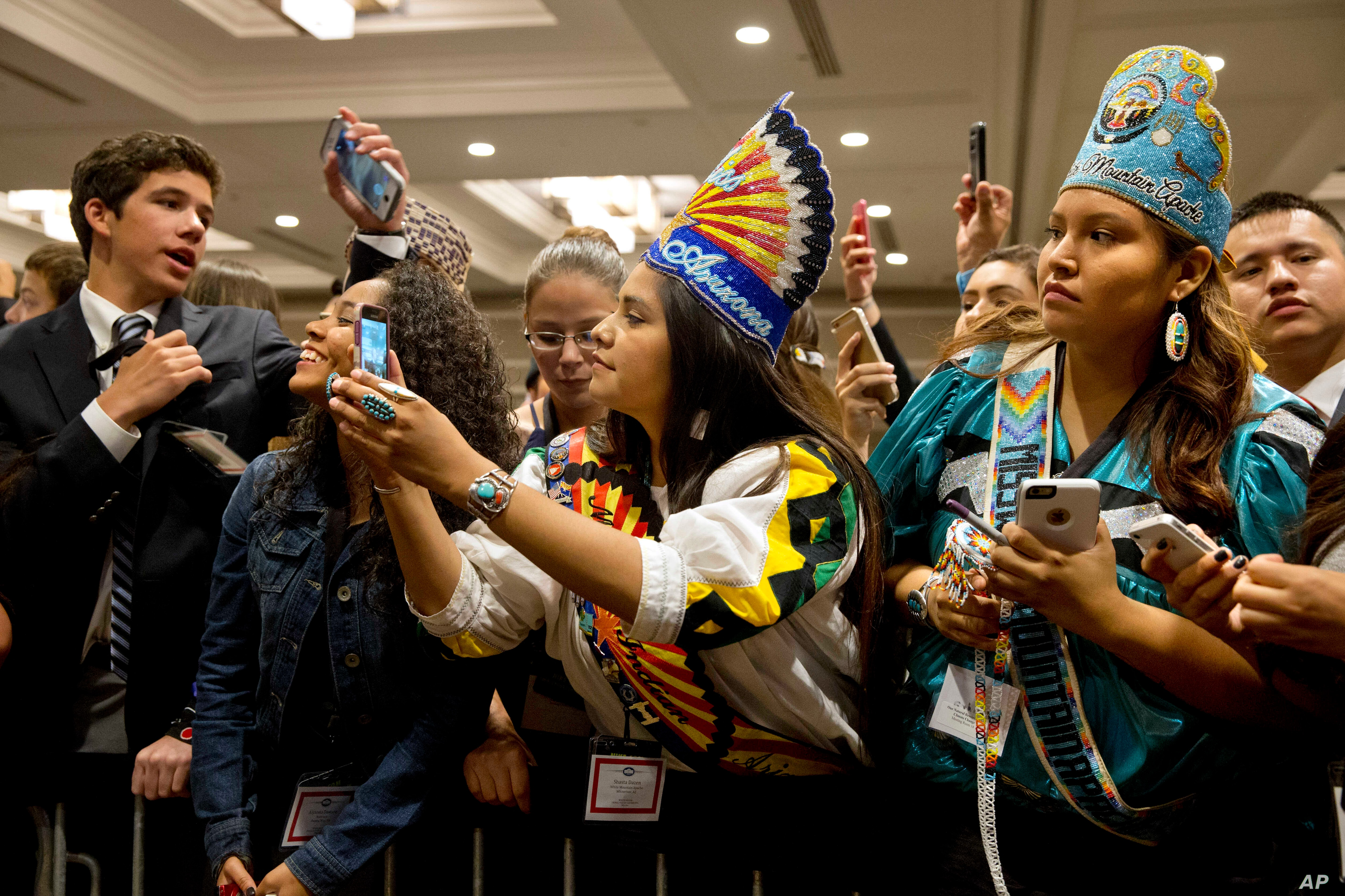 Young native Americans vie for a glimpse of first lady Michelle Obama, after she spoke at the first White House Tribal Youth Gathering, July 9, 2015 in Washington.