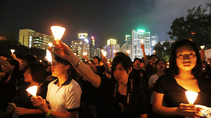 Tens of thousands of people attend a candlelight vigil at Hong Kong's Victoria Park in Hong Kong Monday June 4, 2012 to mark the 23rd anniversary of the June 4th Chinese military crackdown on the pro-democracy movement in Beijing.
