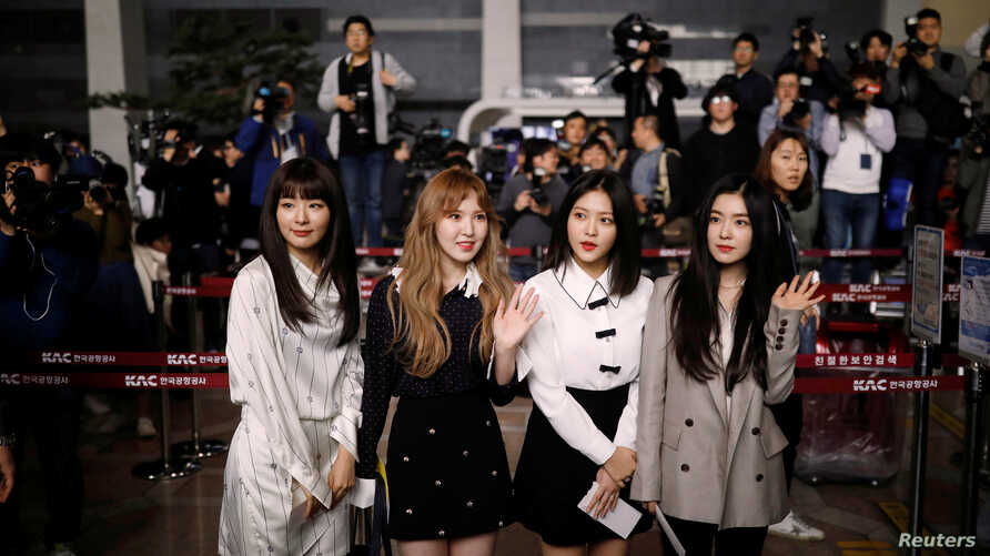 Members of South Korean K-pop girl group Red Velvet leave for Pyongyang at the Gimpo International airport in Seoul, South Korea, March 31, 2018.