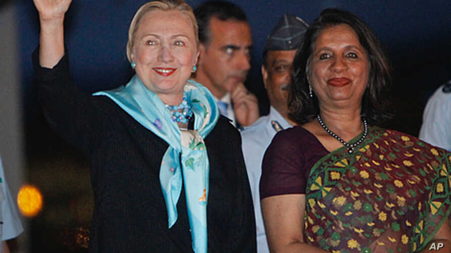 Secretary of State Hillary Clinton (l) waves after meeting with India's Foreign Secretary Nirupama Rao (r) upon her arrival in New Delhi, India, July 18, 2011