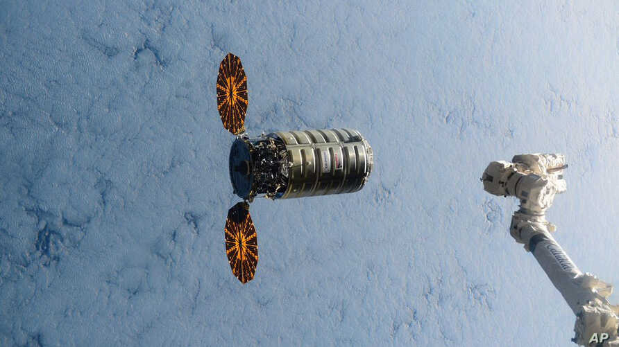 FILE - In this Dec. 9, 2016, file photo made available by NASA via Twitter, a Cygnus spacecraft approaches the International Space Station.