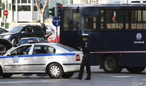 A police car blocks the road  that connects to the Justice Ministry in Athens, Feb 2, 2011