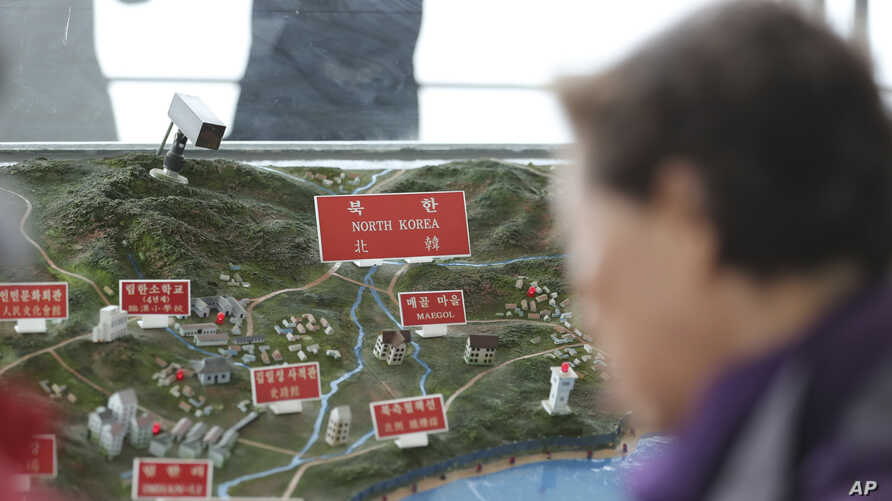 A visitor looks at a map of North Korean towns at the unification observatory in Paju, South Korea, April 25, 2017.
