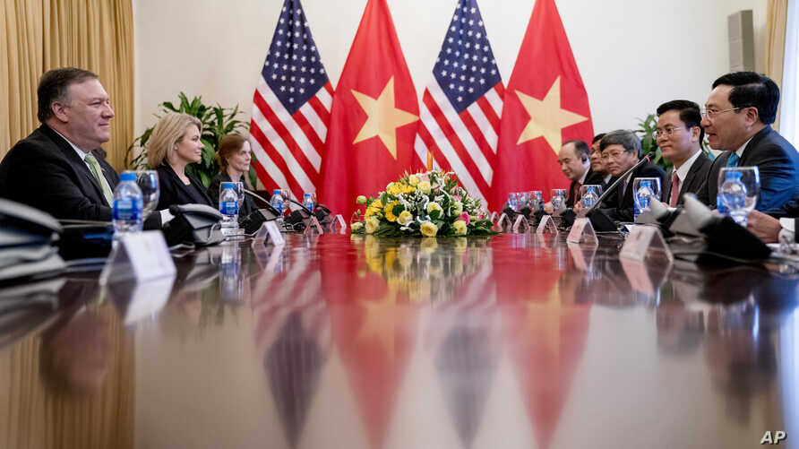 U.S. Secretary of State Mike Pompeo, left, meets with Vietnamese Deputy Prime Minister and Foreign Minister Pham Binh Minh, right, at the Ministry of Foreign Affairs in Hanoi, Vietnam, July 9, 2018