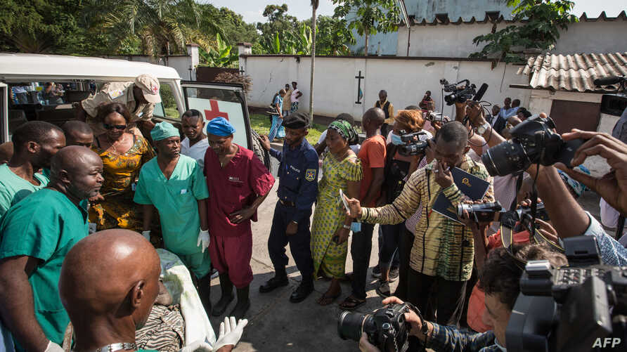The body of a elderly woman is shown to the press at Kinshasa central morgue, on April 13, 2015, where the local governement organized a visit to highlight the need for mass graves after more than 420 bodies were discovered 100 km outside Kinshasa.