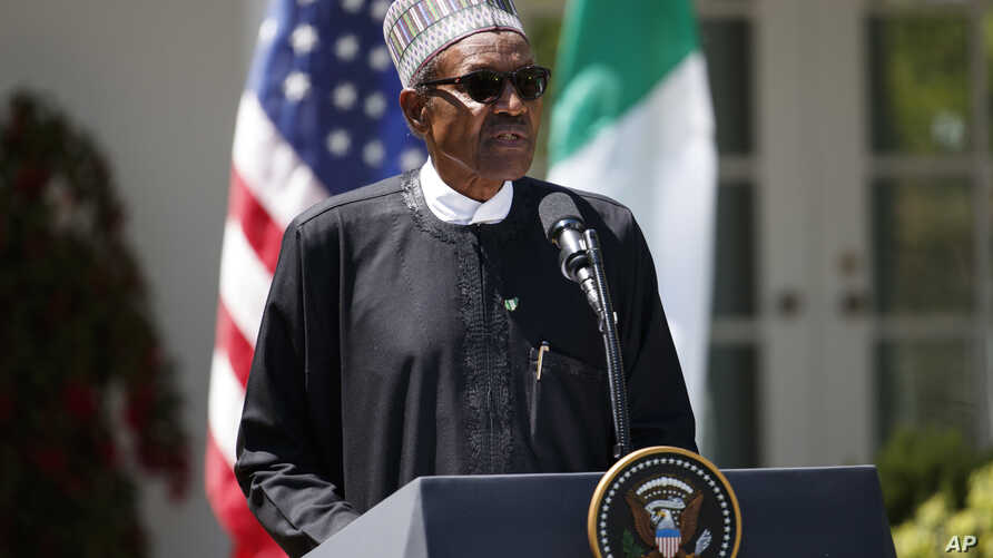 Nigerian President Muhammadu Buhari speaks during a news conference with President Donald Trump in the Rose Garden of the White House in Washington, April 30, 2018.