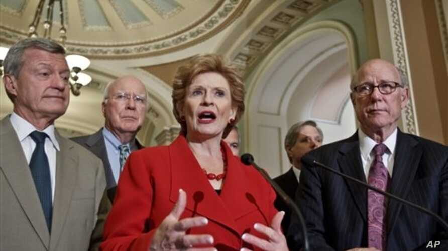 Senate agriculture committee members, led by Sen. Debbie Stabenow, D-Mich., center, praise bipartisan passage of the Farm Bill, Washington, June 21, 2012.