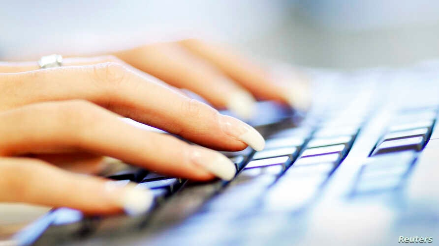 A woman uses a computer keyboard in this photo illustration taken in Sydney, Australia, June 23, 2011. (Reuters)