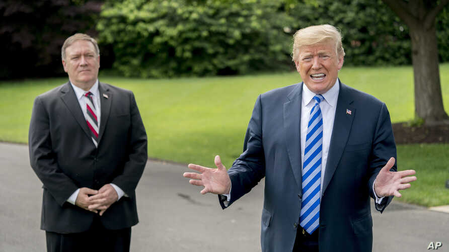 President Donald Trump, accompanied by Secretary of State Mike Pompeo, left, speaks to reporters on the South Lawn outside the Oval Office in Washington, June 1, 2018, after meeting with former North Korean military intelligence chief Kim Yong Chol.