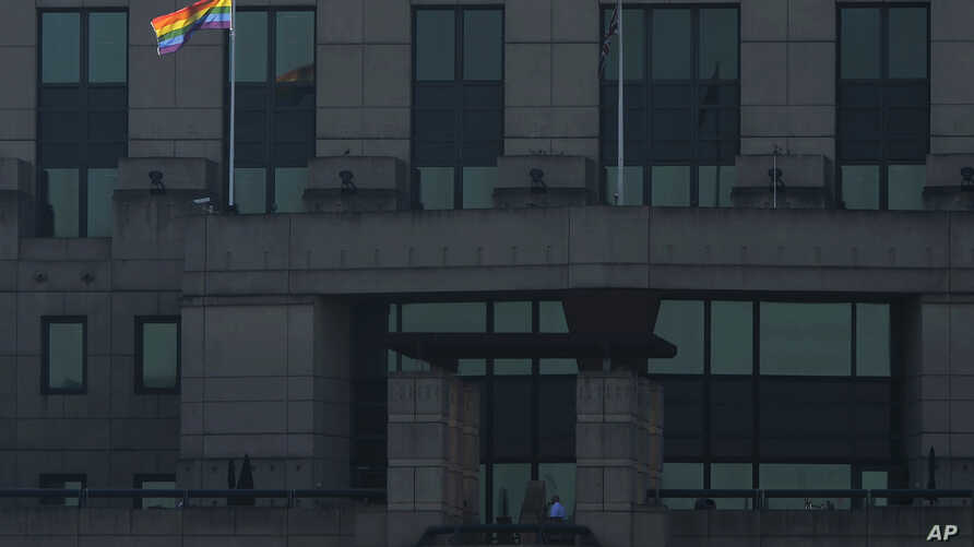 The MI6 Vauxhall Cross building raises the Rainbow Flag to mark its support for the International Day Against Homophobia, Transphobia and Biphobia in London, Britain, May 17, 2016.
