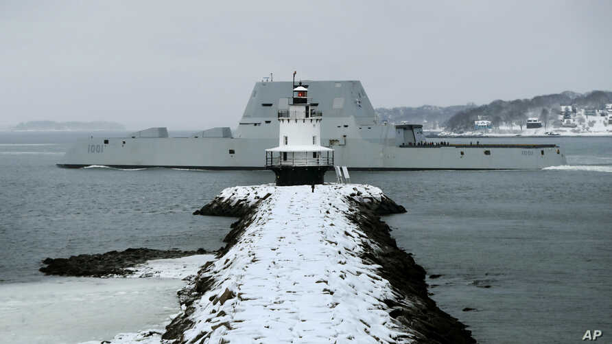 The future USS Michael Monsoor passes Spring Point Light in South Portland, Maine, after performing offshore sea trials, Jan. 17, 2018.