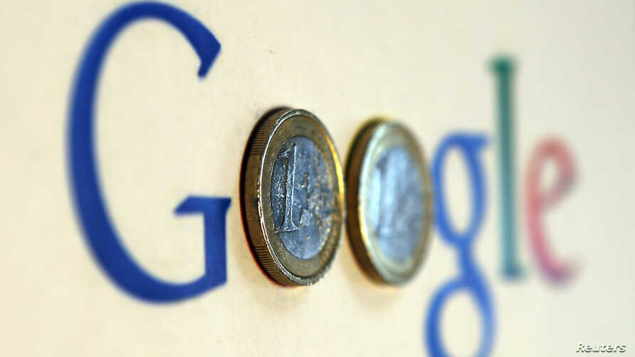 An illustration picture shows a Google logo with two one Euro coins, taken in Munich, Jan. 15, 2013.