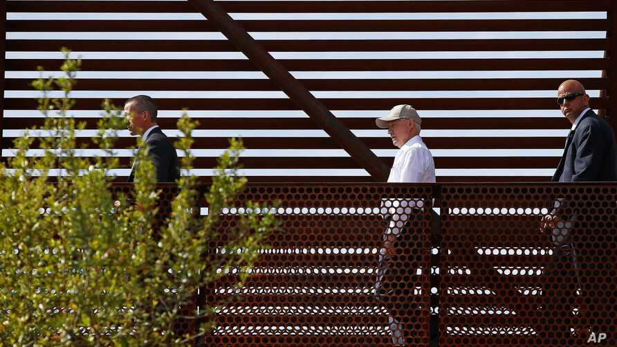FILE - Attorney General Jeff Sessions, center, tours the U.S.-Mexico border with border officials in Nogales, Arizona, April 11, 2017. A courthouse on the border in Texas is serving as a model for the kind of tough immigration enforcement advocated b