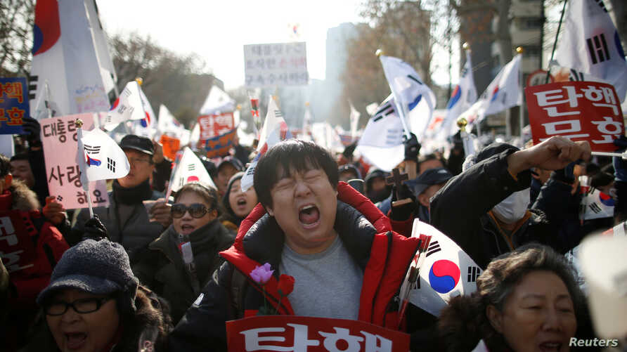 Supporters of South Korean President Park Geun-hye attend a protest opposing her impeachment near the constitutional court in Seoul, South Korea, Dec. 17, 2016.